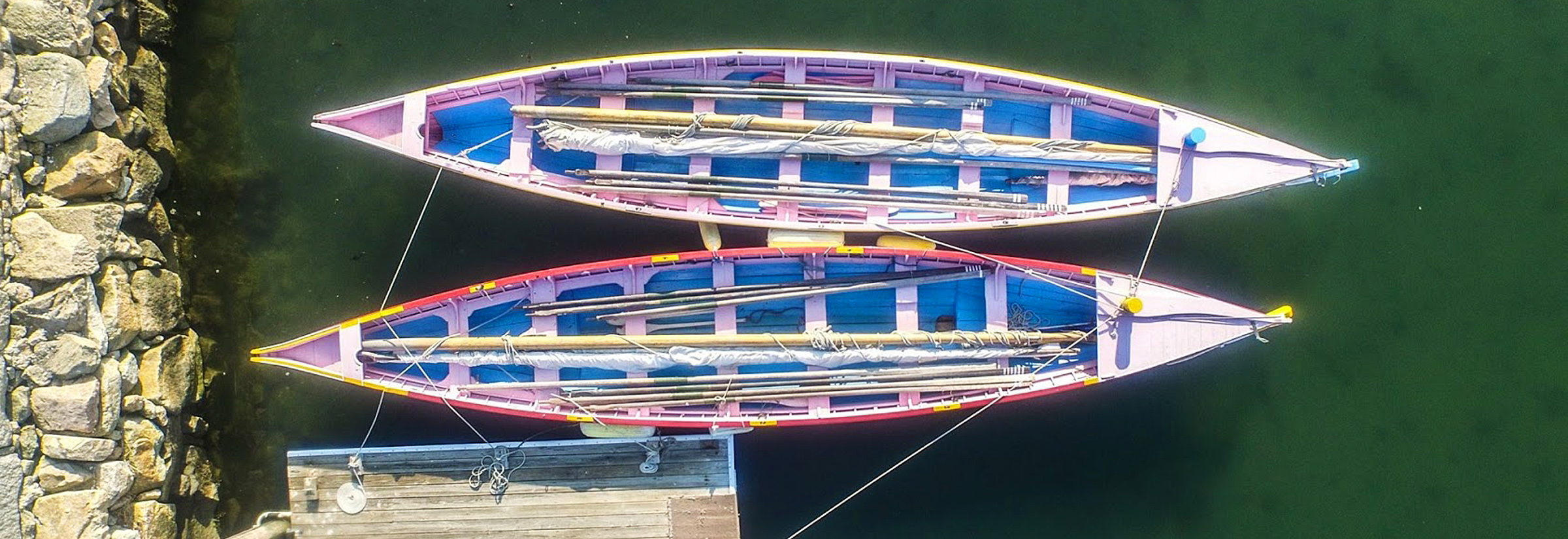 aerial view of two Azorean whaleboats in Clarks Cove in New Bedford, Massachusetts