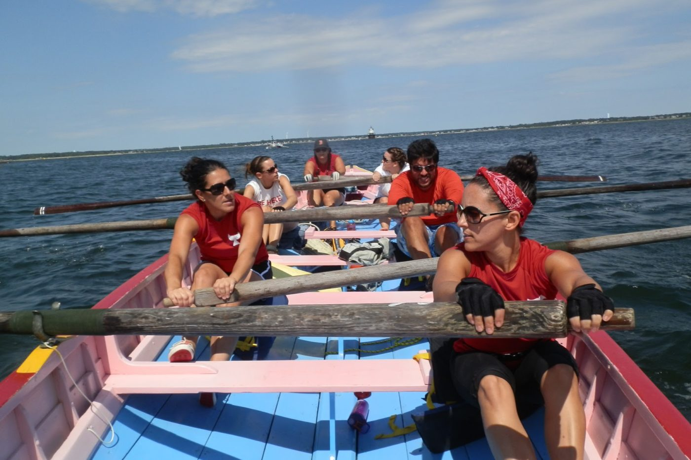 Azorean Maritime Heritage Society rowing in the Light the Bay Regatta in New Bedford