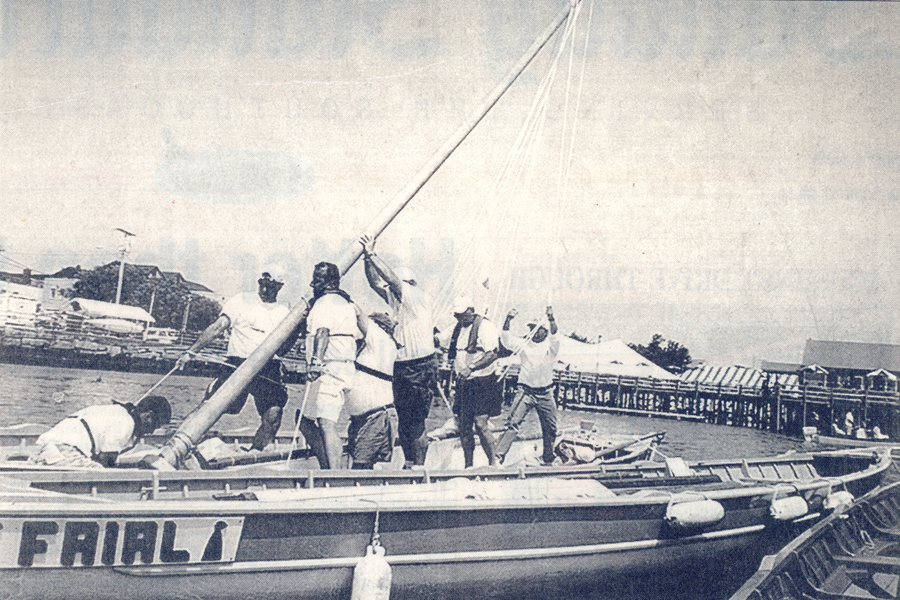 men putting up mast on Azorean whaleboat in New Bedford
